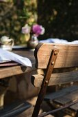 Rustic wooden table and chair on restaurant terrace