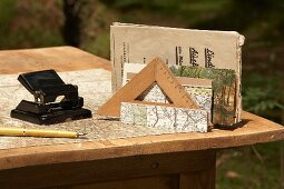 Office supplies and map on desk outdoors