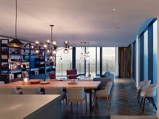 Open-plan interior with continuous glass wall