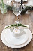 Lion-head bowl on white place setting decorated for Christmas