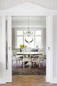 Carved door frame and open sliding door with view of dining area