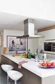 Fruit bowl on island counter with gas hob below extractor hood