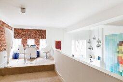Designer standard lamp and workspace on platform on gallery