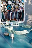 Sewing utensils & various sewing threads in wooden box