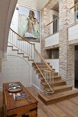 Elegant country-house-style stairwell with exposed brick walls and gallery