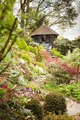 Summer house on a hill in landscaped garden