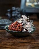 Bunch of gemstone grapes on an antique wooden table
