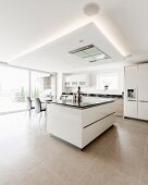 Light-flooded modern kitchen with white cabinets