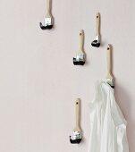 Coat hooks hand-made from paintbrushes