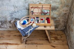 Old wooden slide box repurposed as sewing box and filled with haberdashery