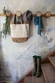 Coat rack made from old yarn reels screwed to wooden lath in vintage interior