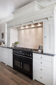Country-house kitchen with decorative moulding and large gas cooker