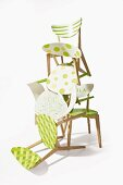 Wooden chairs revamped with patterns of fresh green paint