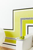 Pattern of horizontal and vertical strips of various wallpapers on wall (detail)