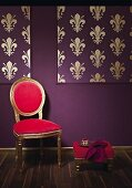 Rococo chair against wall decorated in Baroque gold and purple