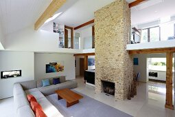 Luxury apartment with stone chimney breast and open-plan interior