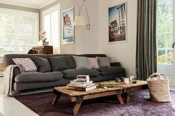 Rustic coffee table in front of dark grey sofa in living room