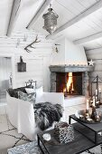 Cosy living room with open fire in log cabin
