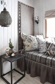 Comfortable daybed with upholstered headboard and valance