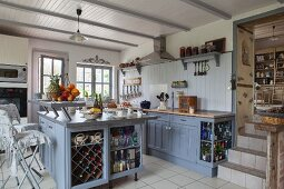 Free-standing, country-house-style island counter painted blue-grey in open-plan kitchen