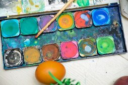 Dyed Easter egg and paintbox