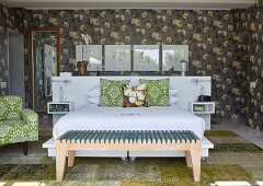Dark grey floral wallpaper and modern bedroom bench in retro bedroom
