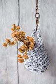 Dried hop flowers in hanging basket made from crocheted Zpagetti-yarn cover