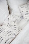 Black-and-white striped and spotted scatter cushions