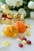 Painted Easter eggs, sugar eggs, chocolate bunnies and tulips