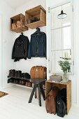 Cloakroom furnishings made from old wooden crates in vintage-style hallway