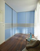 DIY wardrobes with floor-to-ceiling, blue sliding doors