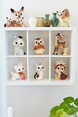 Retro animal figurines in white display case