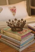 Vintage crown on shabby-chic stack of books