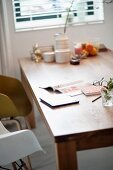 Magazine and tablet on wooden dining table