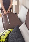 Changing the covers on a headboard cushion