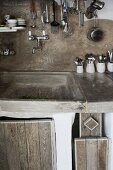 Masonry kitchen counter with rustic wooden doors