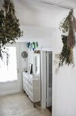 Dried herbs hanging from ceiling