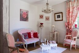 French furniture and red and white fabrics in seating area