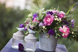 Romantic, summery bouquet on table outdoors