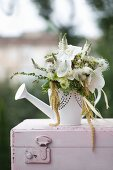 Green and white bouquet with white orchids in watering can