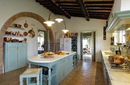 Large, country-house-style Mediterranean kitchen with terracotta floor tiles