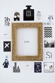 Postcards and photos of various motifs around 'Love' motto in gilt picture frame arranged on wall