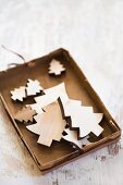 Cardboard box of wooden Christmas-tree decorations