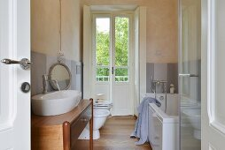 White bathroom suite and oak floor in renovated country house