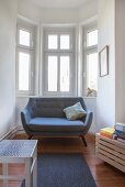 Designer sofa in window bay of period apartment