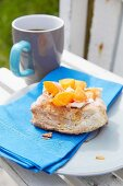 Danish pastry with apricots and blue napkin on plate
