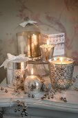 Sparkling silver arrangement of candles, tealight holders and silvered glass