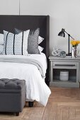 Classic furnishings in bedroom in shades of grey