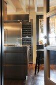 View into elegant kitchen with rustic wooden floor