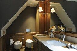 Fitted furnishing in attic bathroom